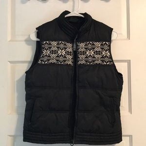 Black puffer vest with snowflake and heart detail